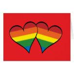 """2 coeurs d'arc-en-ciel sur le rouge - au loin - """"r cartes de vœux"""