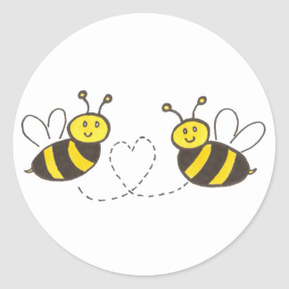 Abeilles de miel avec le coeur autocollant rond
