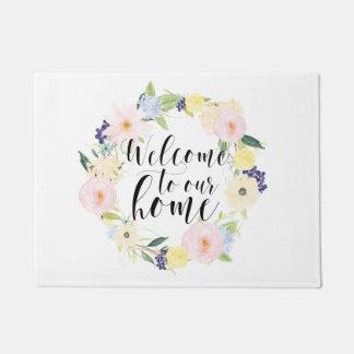 Accueil floral de guirlande de ressort en pastel à paillasson