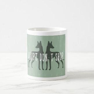 «Adopt, don't shop» mug