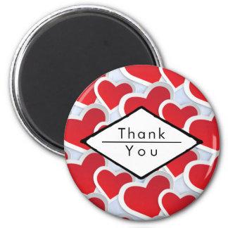 Aimant 2 coeurs rouges répétant le Merci mignon de motif