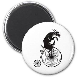 Aimant Chèvre montant un vélo de quart de penny de penny