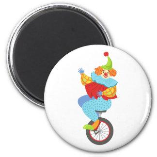 Aimant Clown amical coloré équilibrant sur le monocycle