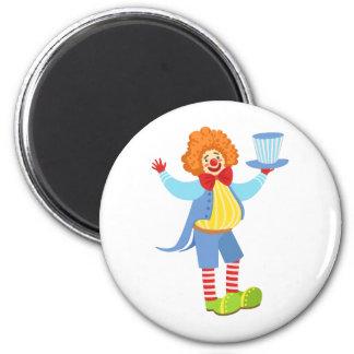 Aimant Clown amical coloré tenant le casquette supérieur