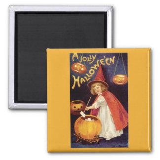 Aimant Halloween vintage, une sorcière mignonne de fille