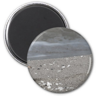 Aimant Le plan rapproché de la plage de sable avec la mer