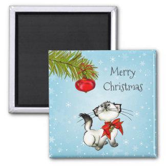 Aimant Noël espiègle Kitty avec l'arc rouge