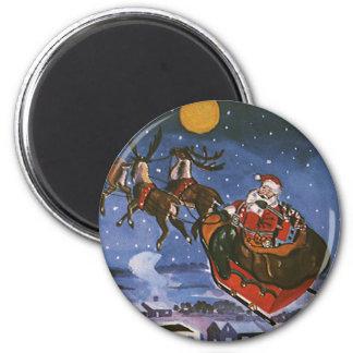 Aimant Noël vintage le père noël pilotant son Sleigh