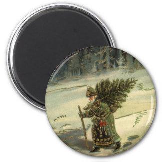 Aimant Noël vintage, le père noël portant un arbre