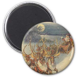 Aimant Noël vintage le père noël Sleigh avec le renne