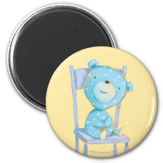 Aimant Ours bleu de calicot souriant sur la chaise