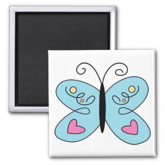Aimant Papillon bleu lunatique avec des ailes de coeur