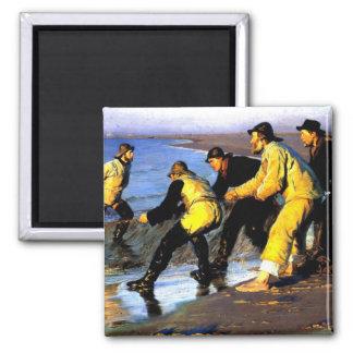 Aimant Pêcheurs transportant le filet sur la plage du
