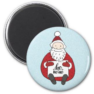 Aimant Père Noël mignon dessinant Noël
