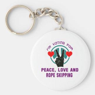Amour de paix et sauter de corde porte-clé rond