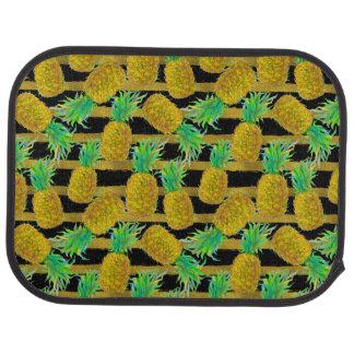 Ananas d'or sur des rayures tapis de sol