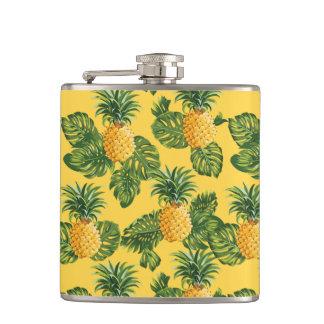 Ananas et feuille tropical sur l'or flasques