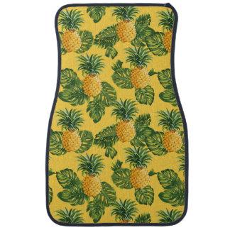 Ananas et feuille tropical sur l'or tapis de voiture