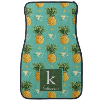Ananas lumineux sur le monogramme géométrique du tapis de sol