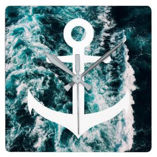 Ancre nautique sur l'arrière - plan de photo horloge carrée