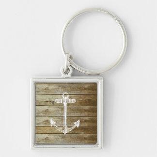 Ancre nautique sur le graphique en bois porte-clé carré argenté