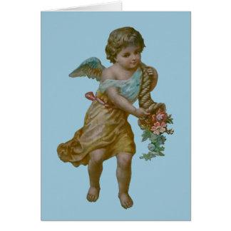 Ange avec la carte de voeux de corne d'abondance