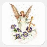 Ange avec la fleur de croix et de clématite adhésif