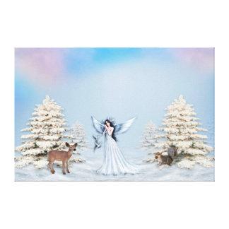 Ange de neige d'hiver avec la vraie toile de