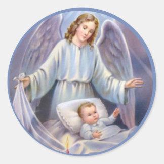 Ange gardien avec le bébé dans la huche sticker rond