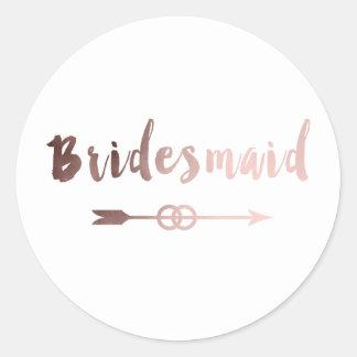anneau de mariage rose élégant de flèche de sticker rond
