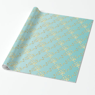 Anneaux de mariage élégants d'or sur bleu-clair papiers cadeaux noël