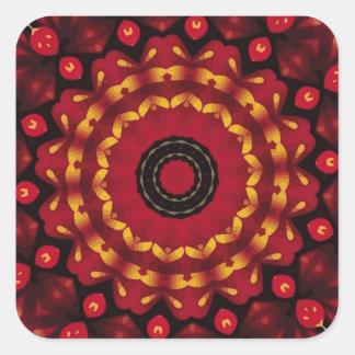 Anneaux d'or sur le mandala rouge sticker carré