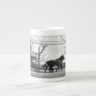 Antan de tasse de porcelaine tendre