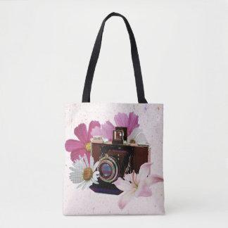 Appareil-photo vintage avec des fleurs sac