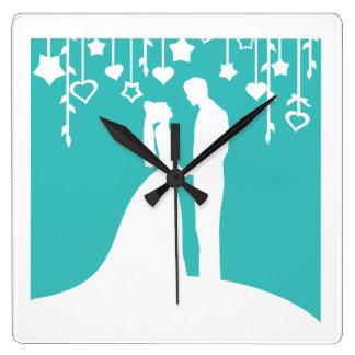 Aqua et silhouettes blanches de mariage de jeunes  horloge carrée