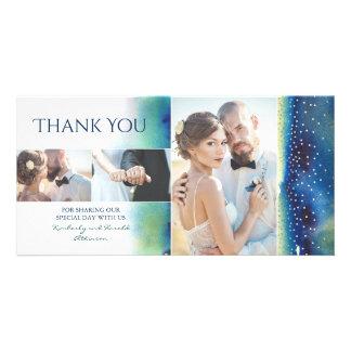 Aquarelles turquoises de confettis d'or épousant carte