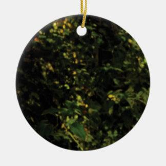 arbres dans le buisson ornement rond en céramique