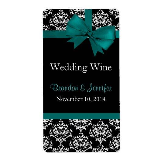 Arc turquoise et mini étiquettes de vin de mariage