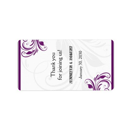 Argent et étiquette floral pourpre de baume à
