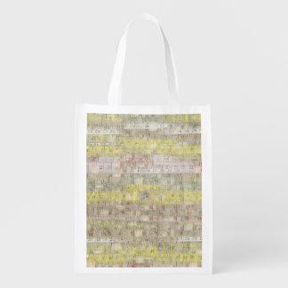 Arrière - plan de mesure fané de bande sacs d'épicerie réutilisables