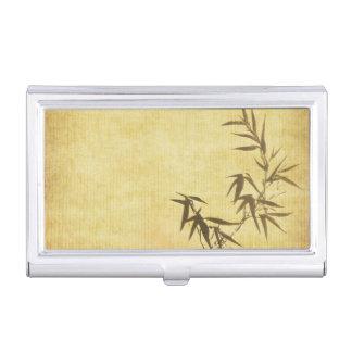 Arrière - plan de papier en bambou souillé par étuis pour cartes de visite