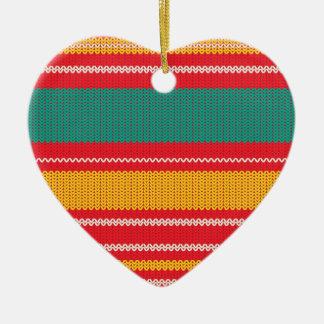 Arrière - plan rayé de tricot ornement cœur en céramique