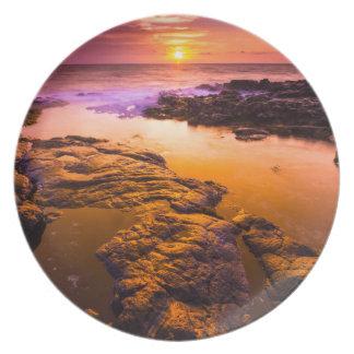 Assiette Coucher du soleil au-dessus des piscines de marée,