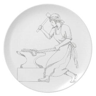 Assiette Forgeron féminin à l'art de griffonnage de travail