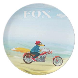 Assiette Fox-Man sur une moto rouge