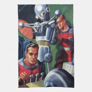 Astronautes vintages de la science-fiction fixant linges de cuisine