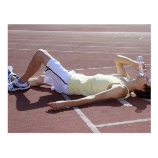 Athlète 2012 olympique buvant après course cartes postales