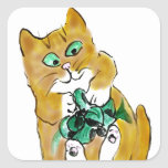 Attaque verte de ruban par le chaton adhésifs