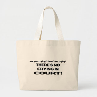 Aucun pleurer devant le tribunal grand sac