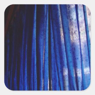 Autocollant bleu abstrait de tissu